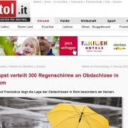 Screenshot eines Zeitungsberichtes über Regenschirme Verteilaktion