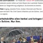 Putin mit Regenschirm während der Siegerehrung der WM 2018
